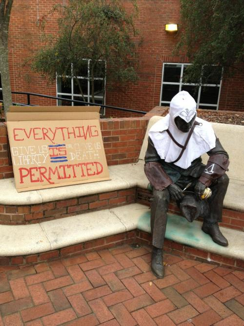 jeweledlight:  GATech has a statue of Dean Griffin, the first Dean of Students on campus and when it gets cold people put their hats and scarves on him. This morning he was dressed a little differently (perfectly).