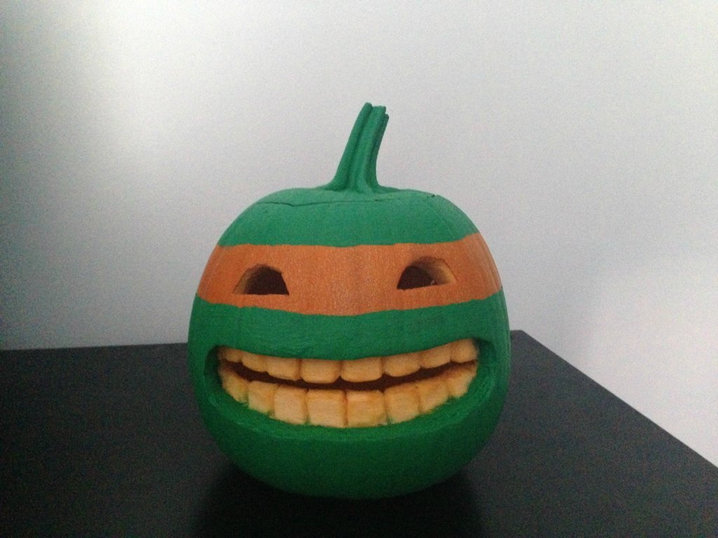 Awesome pumpkin design. I would have flipped out if I had seen this when I was 6 years old!  tastefullyoffensive:  TMNT Pumpkin[via]