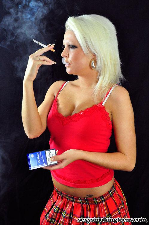 Slutty 19 year old smoker Simone from www.sexysmokingteens.com does a French inhale.