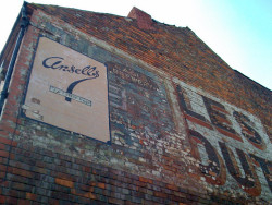 Ghost Signs. The Ghostsigns Project, is a collaborative national effort to photograph, research and archive the remaining examples of hand painted wall advertising in the UK and Ireland. Typically, Ghostsigns are faded remains of advertising that was once painted by hand onto the brickwork of buildings. They can be found in cities, towns and villages across the country advertising many different products and services, some familiar, some less so. Many signs have survived until today but many more have been lost due to weathering, being painted over or their host building being destroyed. The project has created a permanent record of their existence for the benefit of our own and future generations' understanding of this important but often overlooked part of our commercial, craft and advertising history. The work of pulling this together has been co-ordinated among photographers, researchers and other volunteers via the web and is now available as an online archive hosted by the History of Advertising Trust. Check out their website and their Flickr group. If you spot any why not photograph it and submit it to the archive!
