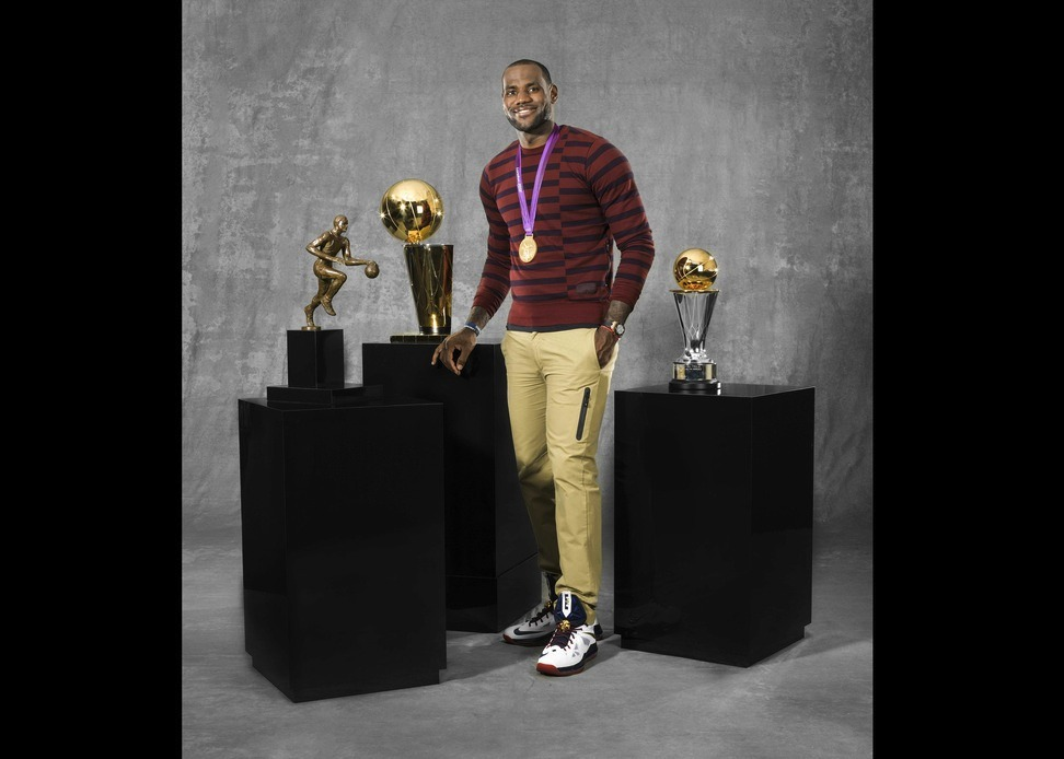 thetickr:  Awkward photo of the day: LeBron James poses with the NBA Championship, Regular Season NBA MVP, NBA Finals MVP Trophy and the Olympic Gold medal. That's a lot of hardware so we'll excuse the awkwardness. (via Nike)  All in a one year. You can actually narrow this down to the month of May through August. Amazing.