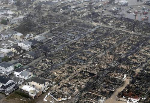 "universeprotector:  ""This aerial photo shows burned-out homes in the Breezy Point section of the Queens borough New York after a fire on Tuesday, Oct. 30. (Mike Groll / AP)"""