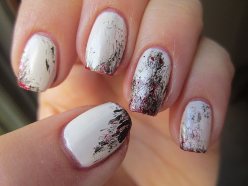 "ghost/demon manicure! polishes used: Julep ""Kate"" for the white, Zoya ""Raven"" for the black, and OPI ""Vodka and Caviar"" for the red.  I painted my nails white and then took the black and wiped off as much as I could off the brush, then lighting ran it over the tips of the nails and the sides.  Then on the ring finger, I did the same thing but did it in the shape of a man.  Then wiped off the brush of the red polish and used the side to dot the eyes and do blood accents around the nails.  what do you guys think??"