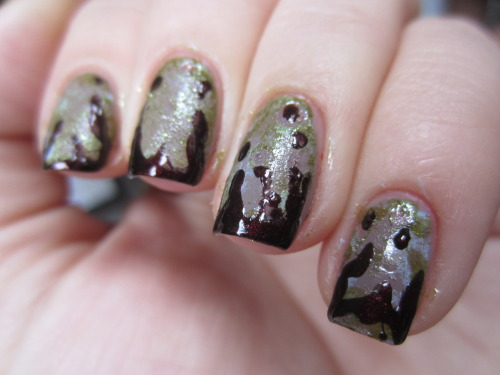 "zombie nails!! polishes used for this were color club ""high society"" for the beige, julep ""jessica"" for the light blue and china glaze ""zombie zest"" for the green.  i sponged the blue and green all around the beige to make it look like dead flesh.  then i used a tooth pick and sephora by opi ""i'm with brad"" to make the dried blood drops.  i loved this!"