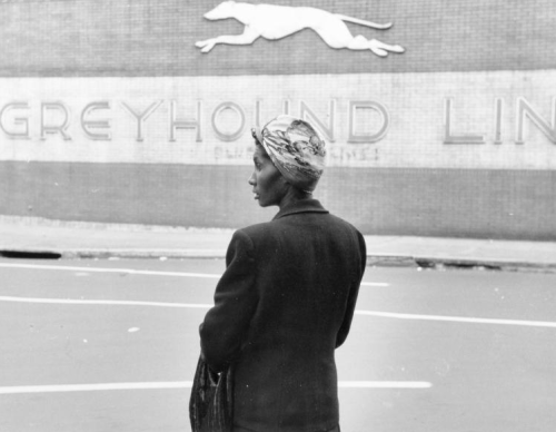Woman Facing towards towards Bus Station, c. 1950 Elliott Erwitt