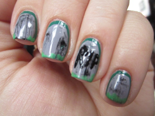 "tombstone nails! i wanted to try out a ruffian manicure but still make it halloween-y! polishes used for this were julep ""emilie"" which is the green in the background near the cuticles, h&m ""miss stone heart"" for the grey tombstones, zoya ""raven"" for the black aging on all the tombstones and the R.I.P. then julep ""leah"" for the grass near the base of the tombstone.  not my best work but still halloween appropriate!"