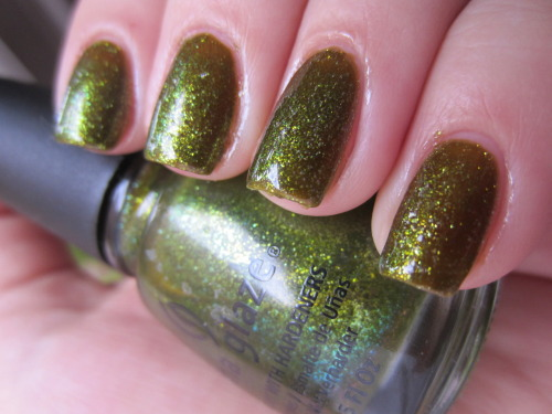 "china glaze ""zombie zest"" one of my FAVORITE polishes of all time! definitely an amazing polish and the fact that it looks like brown green rotting shiny glittery flesh is amazing! it is a little sheer tho, this is 3 coats."