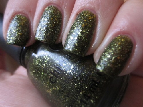 "china glaze ""its alive"" ok last halloween polish, until maybe tomorrow! its alive is a olive green glitter and one of my favorites of all time.  i absolutely love it! the base is a blackened olive green, no brown in there at all, and then theres olive green glitters.  opaque in 2 coats and seriously stunning."