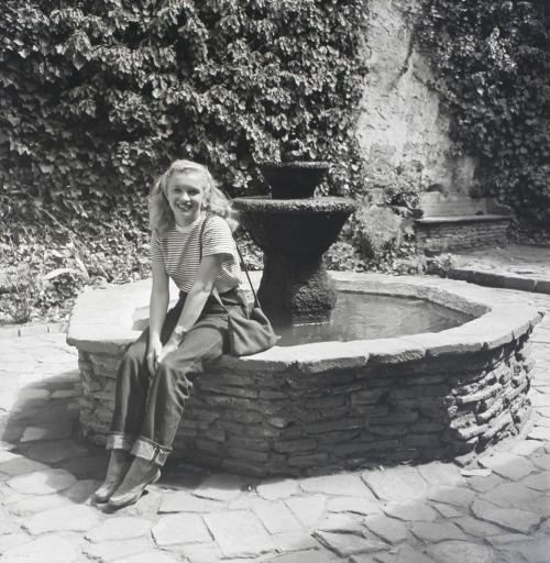 dreaminparis:  Norma Jeane Dougherty (aka Marilyn Monroe) at Capistrano Mission (by Andre De Dienes, 1945).