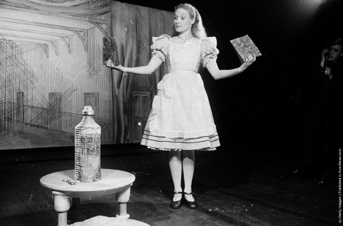 alicismo:  Alice, played by actress Roma Beaumont, has eaten the cake marked 'Eat me' and is now nine feet high. (Photo by Kurt Hutton/Picture Post/Getty Images). 15th January 1944