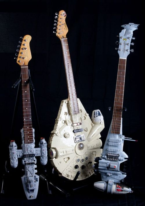 Tom Bingham's Anakin Jedi Starfighter guitar, Millennium Falcon guitar and his B-wing fighter guitar.