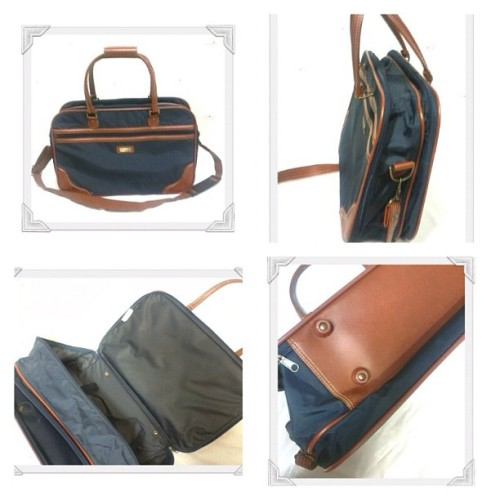 1980's Navy/brown tote/weekender. Folds flat for your hoarding adventures. Long handle and removable strap makes for easy carrying. See etsy.com/shop/realtimetravlbags #realtimetravlr #vintage #luggage #tote #navy #etsy