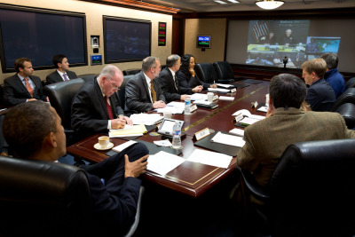 President Barack Obama receives an update on the ongoing response to Hurricane Sandy, in the Situation Room of the White House, Oct. 29 2012. Participating via teleconference, clockwise from top left, are: Secretary of Homeland Security Janet Napolitano; FEMA Administrator Craig Fugate; Rick Knabb, Director of the National Hurricane Center; Secretary of Transportation Ray LaHood; and Secretary of Energy Steven Chu. Pictured, from left, are: Clark Stevens, Assistant Press Secretary; Emmett Beliveau, Director of the Office of the Chief of Staff; John Brennan, Assistant to the President for Homeland Security and Counterterrorism; Richard Reed, Deputy Assistant to the President for Homeland Security; Chuck Donnell, Senior Director for Resilience; Asha Tribble, Senior Director for Response; Chief of Staff Jack Lew; Alyssa Mastromonaco, Deputy Chief of Staff for Operations; Press Secretary Jay Carney; and David Agnew, Director for Intergovernmental Affairs. (Photo by Pete Souza/The White House)