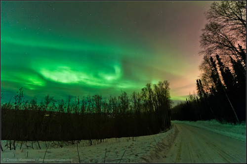 "ikenbot:  Through the Clouds  ""During my first night in Fairbanks, Alaska in February 2012, the clouds broke a bit to reveal some auroral activity in the northern sky. The relatively low clouds are being lit by the reddish-orange light of Fairbanks."" — Dennis Mammana"