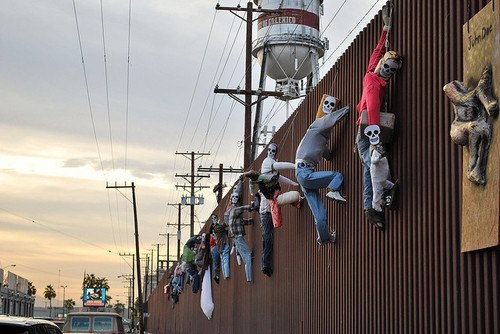 "socialismartnature:  ""Dia de muertos"" @ the Mexico-US Border in Mexicali BC Mexico border with Calexico CA US. In memory of the thousands of Latin@ men, women, and children, killed by racist vigilantes, Border Patrol bigots, and institutional colonialism along the Mexico-US border."