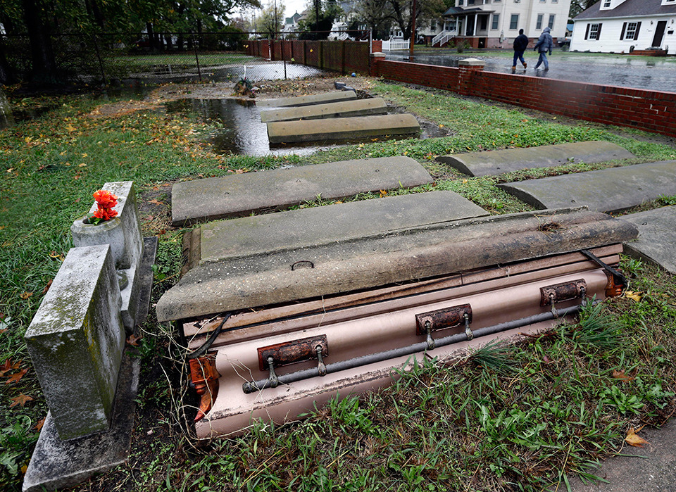 Uh, Happy Halloween? Yikes. Caption:   A casket floated out of the grave in a cemetery in Crisfield, Md. after the effects of superstorm Sandy Tuesday, Oct. 30, 2012. Hundreds of people were displaced by floodwaters in Ocean City and in Crisfield. At the same time, 2 feet of snow fell in westernmost Garrett County, were nearly three-quarters of residents lost power. (AP Photo/Alex Brandon)