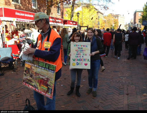 atheist-overdose:  These girls made their own sign and stood next to him all day.follow for the best atheist posts on tumblr
