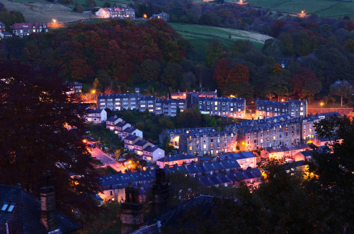 Today's Photo Illuminated Triangle. Hebden Bridge is beautiful at night, don't you agree? This was shot towards the end of Blue Hour as I was hiking back down from Hebden Bridge's neighbour Heptonstall (Heptonstall sits on top of the Calder Valley, Hebden Bridge runs through the middle of it at the bottom). Hebden Bridge has an interestingly content, totally friendly and open atmosphere at night; the town centre still has shops open and various market stalls peddling locally produced goods are still serving. Whereas I'm used to a town centre full of pubs, clubs, drunk people, police and brawls, Hebden Bridge was full of people chilling out at the centre, huddled around market stalls, filling up flagons of local-produced cider whilst munching on a sausage butty made from locally-reared and totally ethically bred pigs in nearby Todmorden. I know which one I prefer.
