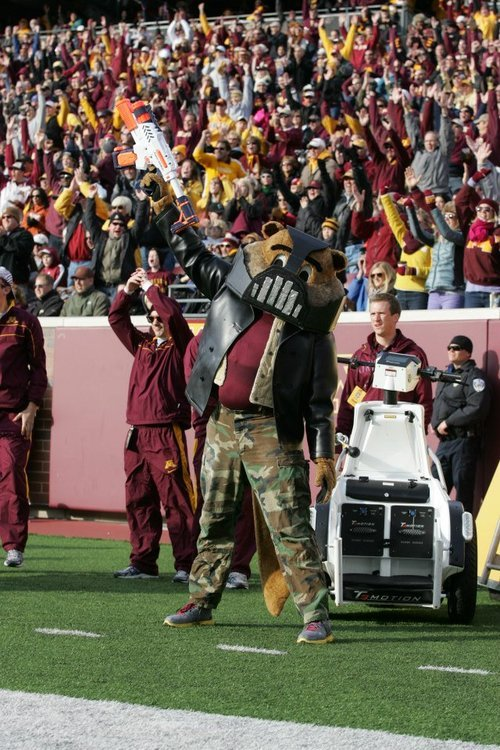 super-marvelous:  University of Minnesota mascot: Goldy Gopher, as Bane! YES! XD  Reason #314159265358 why our mascot is the best.