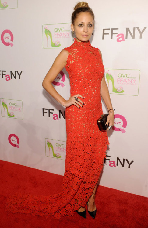 People watching: Nicole Richie stuns in a red lace gown by Scanlan & Theodore and sleek Christian Louboutin heels. Learn more about her look here »