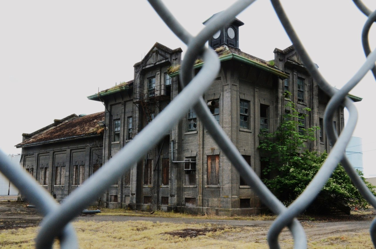 Abandoned building off Hwy 30, west of Portland, Oregon This creepy building was a gas manufacturing plant operated by Portland Gas and Coke from 1912 to 1957.