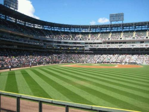 "Where are ""Good seats to catch a home run"" at U.S Cellular Field? Angleal04 says they are ""behind the away bullpen."" This is the great photo she took, while watching the Chicago White Sox at home, from those seats. (via U.S. Cellular Field section 105 row 12 seat 7 - Chicago White Sox vs Tampa Bay Rays shared by angleal04)"