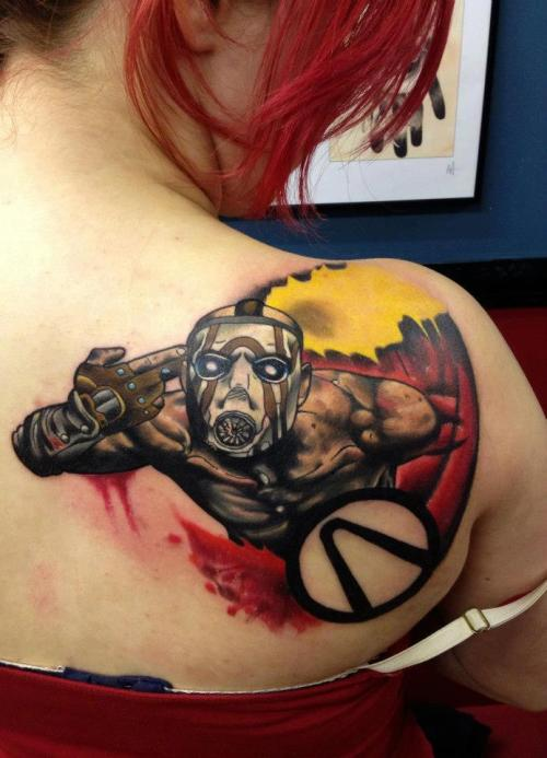 best-tattoos:  Borderlands tattoo Done with Eternal ink triple black and Kiro Sumi lining black, all the rest of the colours were Eternal ink Edit: The owner of this tattoo is on tumblr @ http://dollyfox.tumblr.com/