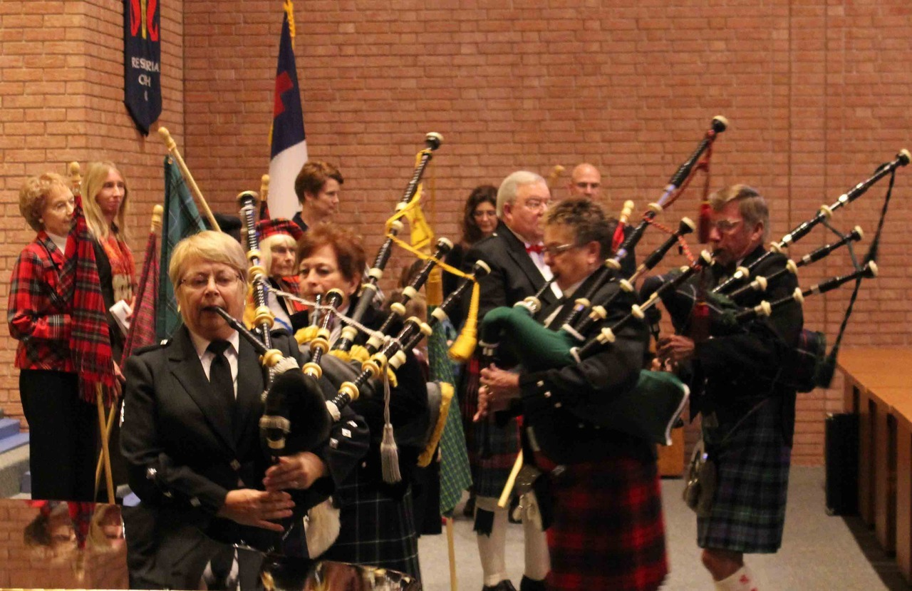 "Churchgoers at First Presbyterian Church of Columbia celebrate their Scottish heritage with bagpipes, drums and plaid in the church's first Kirkin' o' the Tartans ceremony. Worshipers with roots in nearly 30 Scottish clans carried their ""tartans"" — or plaid patterns worn on kilts, flags and hats — in a procession accompanied with music from the Boone County Fire Protection District Pipes and Drums. The ceremony took place Oct. 28 during the celebration of Reformation Sunday.  Listen to more First Presbyterian Church bagpipes on ColumbiaFAVS.com"