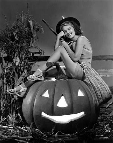 Anne Nagel on a Jack-O-Lantern couldn't be sweeter! via Flickr user Paladin.
