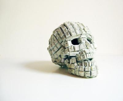 Keyboard skull, made by South Africa-based artist Maurice Mbikayi, who incorporates computer components, among various found objects, into his work.  The resultant mixed media drawings and sculptures ask questions such as to whom such technological resources are made available and at what or whose expense? What are the consequences impacting on our people and environment?  Find more info and photos on his site here. (Photo via Juxtapoz Magazine)