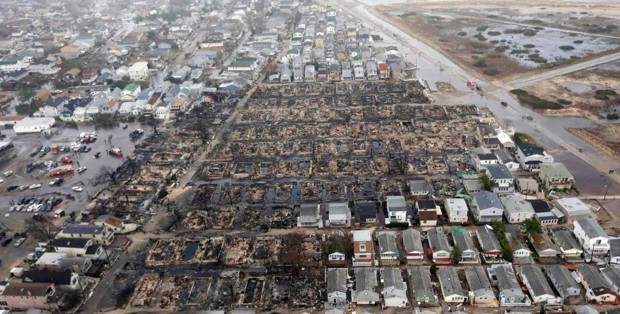 AP photo of Breezy Point, Queens. http://gothamist.com/2012/10/30/heres_how_to_volunteer_time_money_t.php