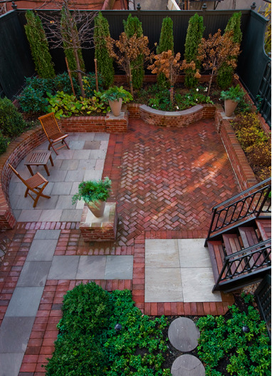 Traditional patio with brick and Pennsylvania Bluestone for a Brooklyn, New York back yard. No garden/landscape designer was mentioned. The addition on the house was designed by Brooklyn architect Ben Herzog. Perhaps he designed the garden too?