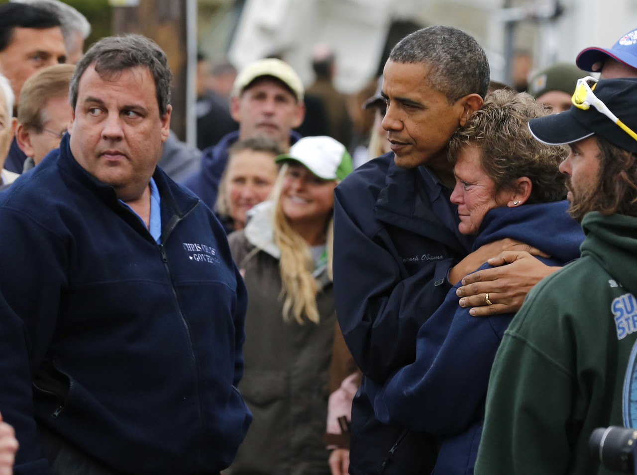 reuters:  U.S. President Barack Obama (3rd L) hugs North Point Marina owner Donna Vanzant as he tours damage done by Hurricane Sandy in Brigantine, New Jersey, October 31, 2012. At left is New Jersey Governor Chris Christie. Putting aside partisan differences, Obama and Christie toured storm-stricken parts of New Jersey together on Wednesday, taking in scenes of flooded roads and burning homes in the aftermath of superstorm Sandy. REUTERS/Larry DowningNEWS/UPDATES/RESOURCES: Live coverage of storm Sandy recovery