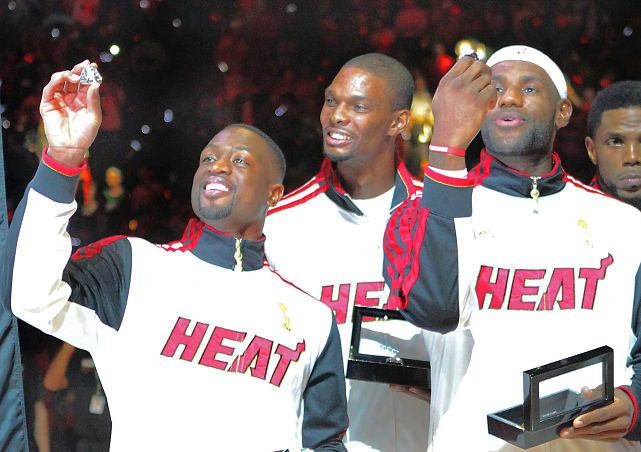 The Miami Heat's Dywane Wade, Chris Bosh and LeBron James receive championship rings before the season-opener against the Celtics on Tuesday. (David Santiago/El Nuevo Herald/MCT via Getty Images) GALLERY: NBA Title RIngs Over the Years