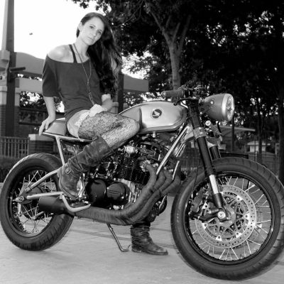 Sofi Tsingos (parts lady at Ducati Dallas) and her 1977 Honda CB550 cafe racer build. Words on the process from Sofi-  My dad and I started to really get into Cafe bikes back in 09'. Found a new way to express another kind of art, kinda like hot rods. We looove old cars and hot rods. My Dad started reading up on the old Tritons, he found a frame and started piecing one together. I kept saying I wanted to build one too and started doing my own research. I was thinking about an old Ducati bevel but those where hard to find cheap. I was having a really hard time in life at the time so my Dad got me the CB550 for christmas to give me something else to focus on. Became obsessed with ready other peoples creations on different forums and the cafe racer magazines. Pulling all my favorite parts of each bike and created my own vision I guess… About a 3rd of the way through, my Dad and I moved back to texas where I got a full time job as a tech with Ducati Dallas so that took most of my time. Also had aother project I started and had to finish. The bike continues to bomb around town with me a couple times a week. I absolutely love it and will never sell it.  [ More photos of Honda CB's | of Sofi Tsingos ]