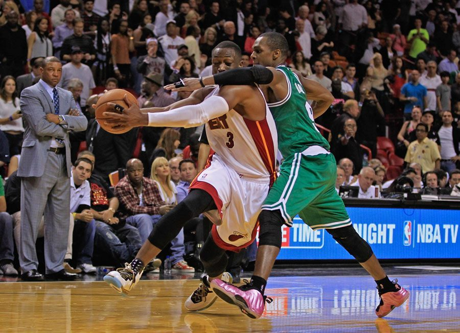 Photo: D-Wade takes a shot from Rondo.