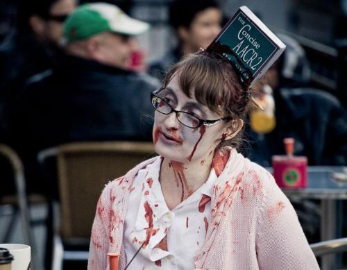 "misslibrelula:  libraryjournal:  liblife:  hearttandbrain:  Happy Halloween, Librarians ;) (""The concise AACR2"" - Zombie librarian - Toronto Zombie Walk 2008. Photo by Sam Javanrouh)   Catalogers rock!  A belated library Halloween pic!"