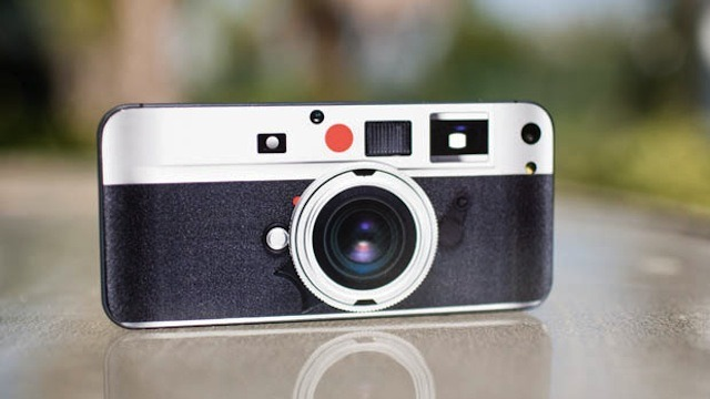 The Easiest Way to Get a Leica Camera Is with This iPhone 5 Sticker By Casey Chan Let's be honest, most of us couldn't afford a Leica camera and would do unspeakable things for one. But don't worry! You don't have to! You can buy a Leica Camera sticker for your iPhone 5 to front like you have a Leica.[[MORE]] It's only $6 and shipping is free and comes with front stickers that makes your iPhone 5 look even more like a Leica. The sticker has cutouts for the camera and flash and could act  as a pseudo-case for your iPhone, without any added bulkiness. Not bad! [PetaPixel Store]
