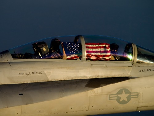 fuckyeahusnavy:  An F/A-18F Super Hornet assigned to the Red Rippers of Strike Fighter Squadron (VFA) 11 displays the national ensign in the cockpit. VFA-11 is embarked aboard the aircraft carrier USS Enterprise (CVN 65), which is deployed to the U.S. 5th Fleet area of responsibility conducting maritime security operations, theater security cooperation efforts and support missions as part of Operation Enduring Freedom.   Fuck, seriously flyboys? The stars to in the direction of travel like it is blowing in the wind. This flag would mean you are flying backwards. Unfuck your shit, either take a picture from the other side or turn the flag around. You are Navy officers, you should know better. This is the flag you represent, try and get it right.
