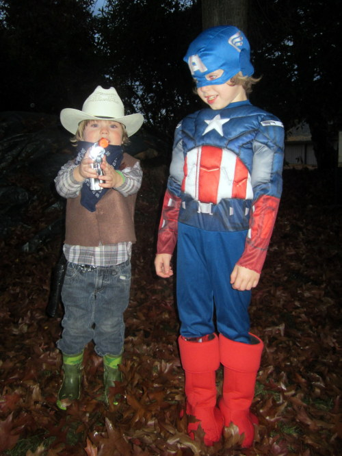 My boys this year. Silas as a cowboy, Bailey as Captain America. Bailey got so much candy trick or treating, the handle on his bag broke. And Silas chewed through a glow stick so we had to call poison control. Non-toxic, whew! They're off to bed and I'm about to dig through their candy stash to steal a few pieces. Happy Halloween!
