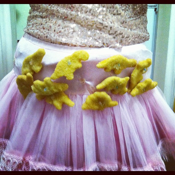 Some girl was wearing Dino-chicken nuggets.