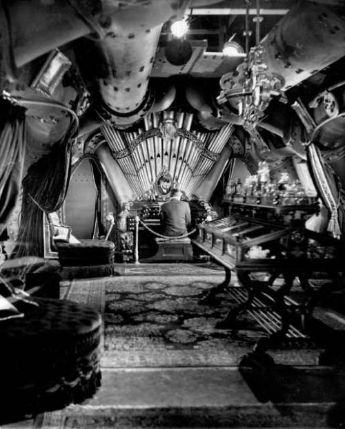 James Mason playing the organ in the magnificent Nautilus Salon; designed by Harper Goff, with set decoration by Emile Kuri.