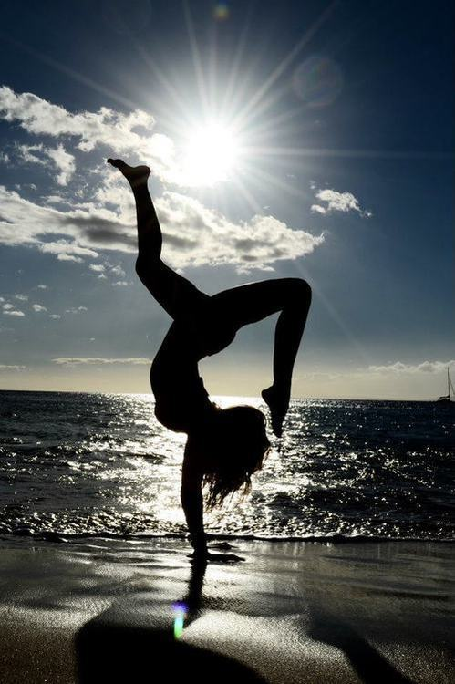 fuckyeahyoga:  handstands on the sand are kind of hard.