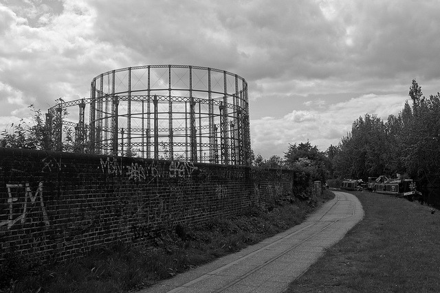 Gas holders by the canal on Flickr.Gas holders by and narrow boats on the Grand Union Canal in Kensal Green, London.