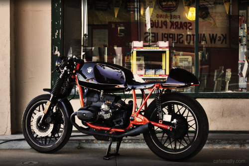 BMW boxers seem to be the flavour of the month in the Cafe Racer world at the moment.  Another bike that is hard to make look worse than stock but a lot of people give it a shot.  Matty seems to have nailed this one though. I don't remember seeing pearl paint used on a bike before (garish sportbikes don't count), certainly not a cafe racer. Bunch more pics on his blog, check'em out. Like us on Facebook