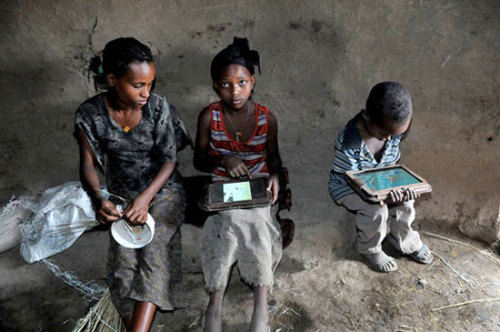 "journo-geekery:  crookedindifference:  Ethiopian kids hack OLPCs in 5 months with zero instruction  What happens if you give a thousand Motorola Zoom tablet PCs to Ethiopian kids who have never even seen a printed word? Within five months, they'll start teaching themselves English while circumventing the security on your OS to customize settings and activate disabled hardware. The One Laptop Per Child project started as a way of delivering technology and resources to schools in countries with little or no education infrastructure, using inexpensive computers to improve traditional curricula. What the OLPC Project has realized over the last five or six years, though, is that teaching kids stuff is really not that valuable. Yes, knowing all your state capitols how to spell ""neighborhood"" properly and whatnot isn't a bad thing, but memorizing facts and procedures isn't going to inspire kids to go out and learn by teaching themselves, which is the key to a good education. Instead, OLPC is trying to figure out a way to teach kids to learn, which is what this experiment is all about. Rather than give out laptops (they're actually Motorola Zoom tablets plus solar chargers running custom software) to kids in schools with teachers, the OLPC Project decided to try something completely different: it delivered some boxes of tablets to two villages in Ethiopia, taped shut, with no instructions whatsoever. They just left the boxes there, sealed up, containing one tablet for every kid in each of the villages (nearly a thousand tablets in total), pre-loaded with a custom English-language operating system and SD cards with tracking software on them to record how the tablets were used. Here's how it went down, as related by OLPC founder Nicholas Negroponte at MIT Technology Review's EmTech conference last week: ""We left the boxes in the village. Closed. Taped shut. No instruction, no human being. Within four minutes, one kid not only opened the box, but found the on/off switch. He'd never seen an on/off switch. He powered it up. Within five days, they were using 47 apps per child per day. Within two weeks, they were singing ABC songs [in English] in the village. And within five months, they had hacked Android. Some idiot in our organization or in the Media Lab had disabled the camera! And they figured out it had a camera, and they hacked Android.""   I can also imagine how quickly the kids learned they'd have to teach their parents, along with associated frustrations.  Amazing"