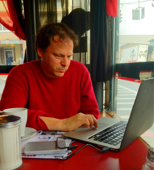 David Graeber researching his next book on Bureaucracies at Cafe Tango in Saugerties NY