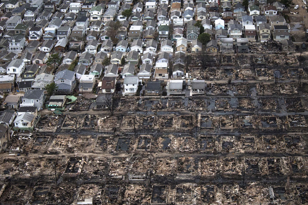 "This is an amazing but heartbreaking photo…Over 80 houses were burnt down in Breezy Point, Queens. | The Atlantic's ""Hurricane Sandy: The Aftermath"")"