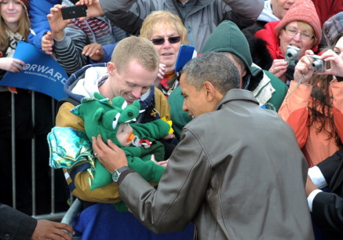 Obama greets a supporter at a campaign rally in Wisconsin. Photo: AFP/Getty Images