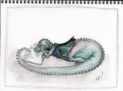 This little dragon prefers a good book to princesses and the like.